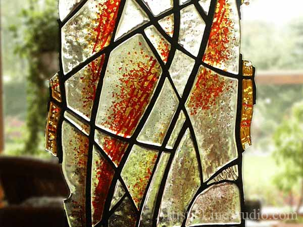 Contemporary style suspended stained, fused and leaded glass sculpture private residence close up