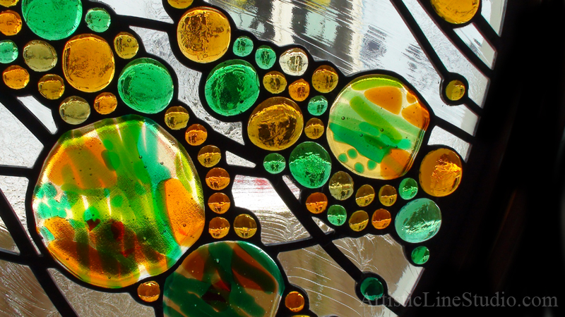 Stained leaded glass oval window in contemporary abstract style by glass artist Victoria Balva