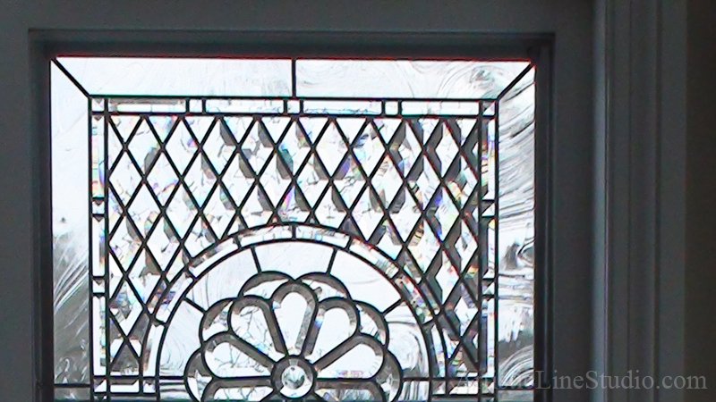 Glass window detail with transom window detal of beveled glass cluster